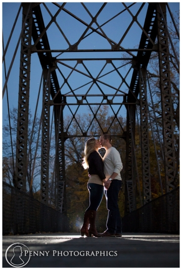 Romantic night kiss under steel bridge Minneapolis