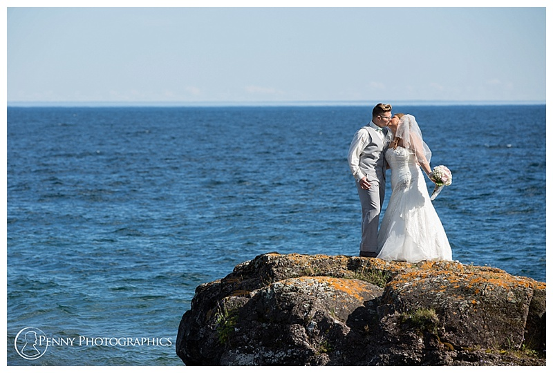 Great Lakes Wedding couple coastline kiss